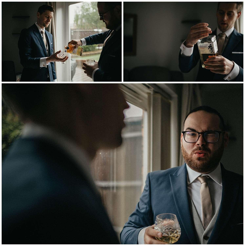 Wedding at Foxhills, Surrey Wedding Photographer - Groomsmen drinking whisky