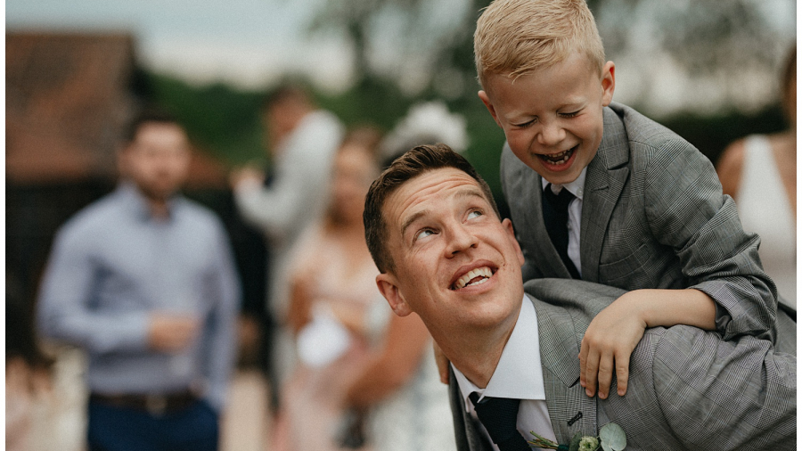 Weddings at Crondon Park - The groom laughing with his son