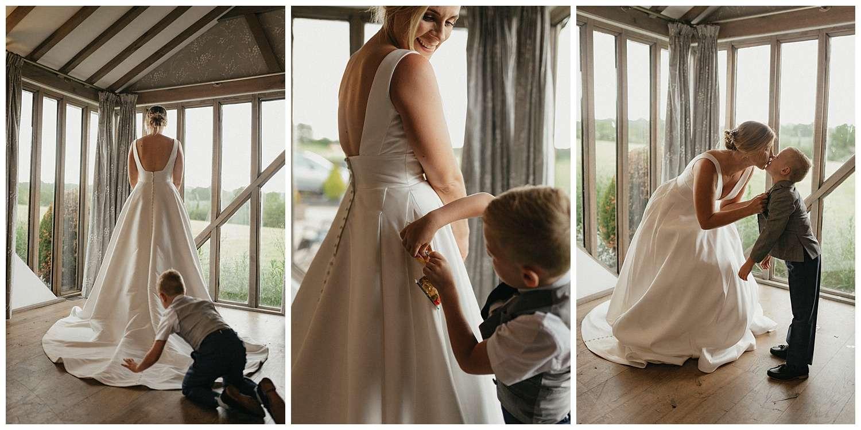 Weddings-at-Crondon-Park-son-puts-sweets-into-brides-dress