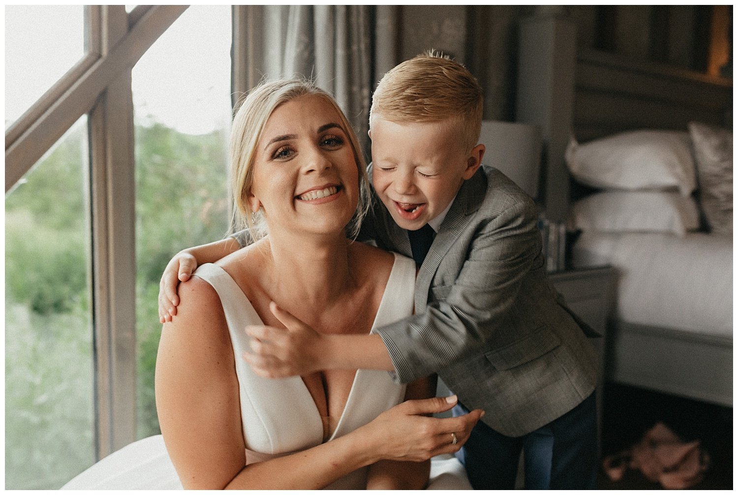 Weddings-at-Crondon-Park-the-bride-and-son-laugh