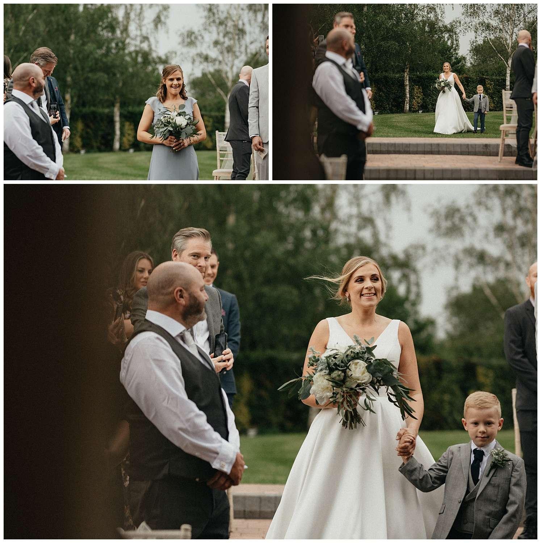 Weddings-at-Crondon-Park-the-smiling-bride-walking