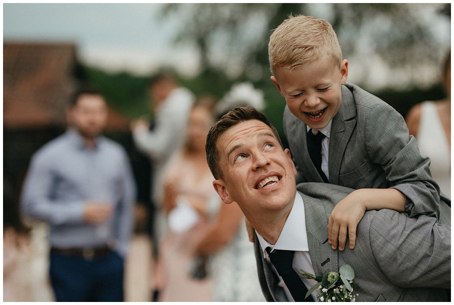 Weddings-at-Crondon-Park-the-groom-and-son-laugh