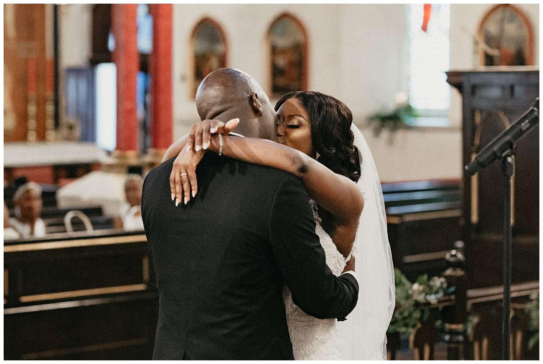 London Wedding Photographer - bride and groom kiss