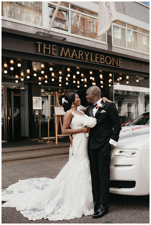 London Wedding Photography - The couple pose next to their wedding car