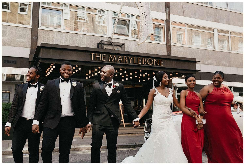 London Wedding Photographer - image of the wedding party walking together
