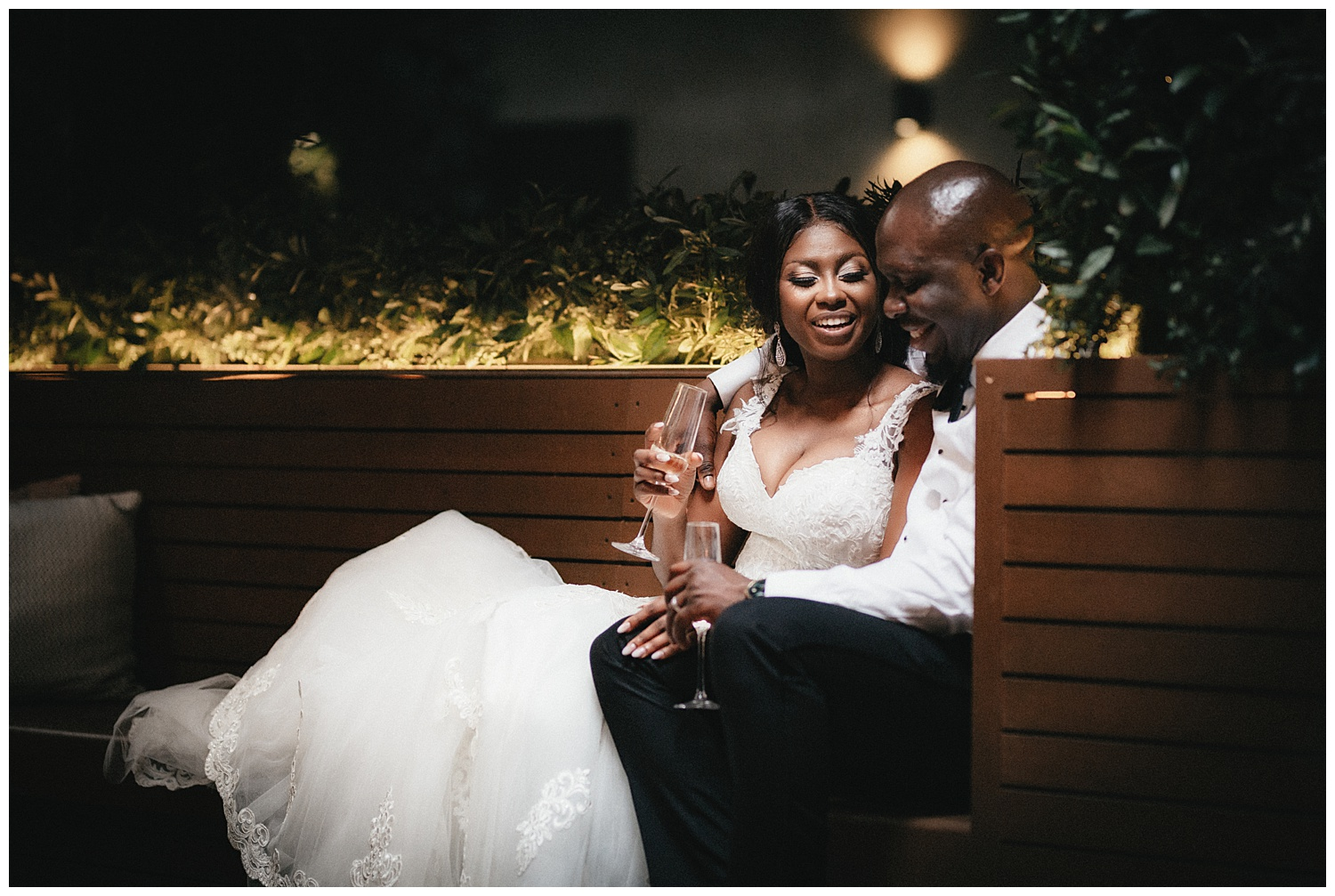 London Wedding Photographer - the couple cosy up together on a bench