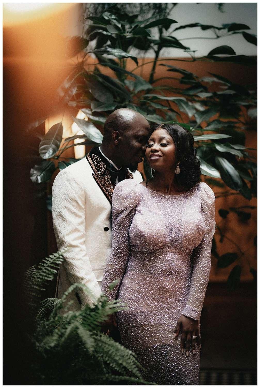 London Wedding Photographer - the couple pose next to the plants