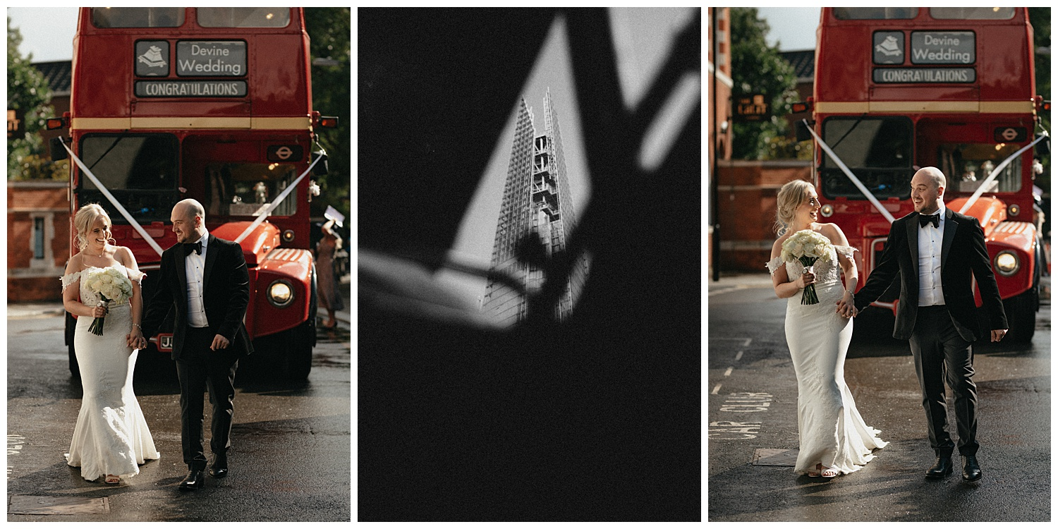 Bride and groom next to red bus