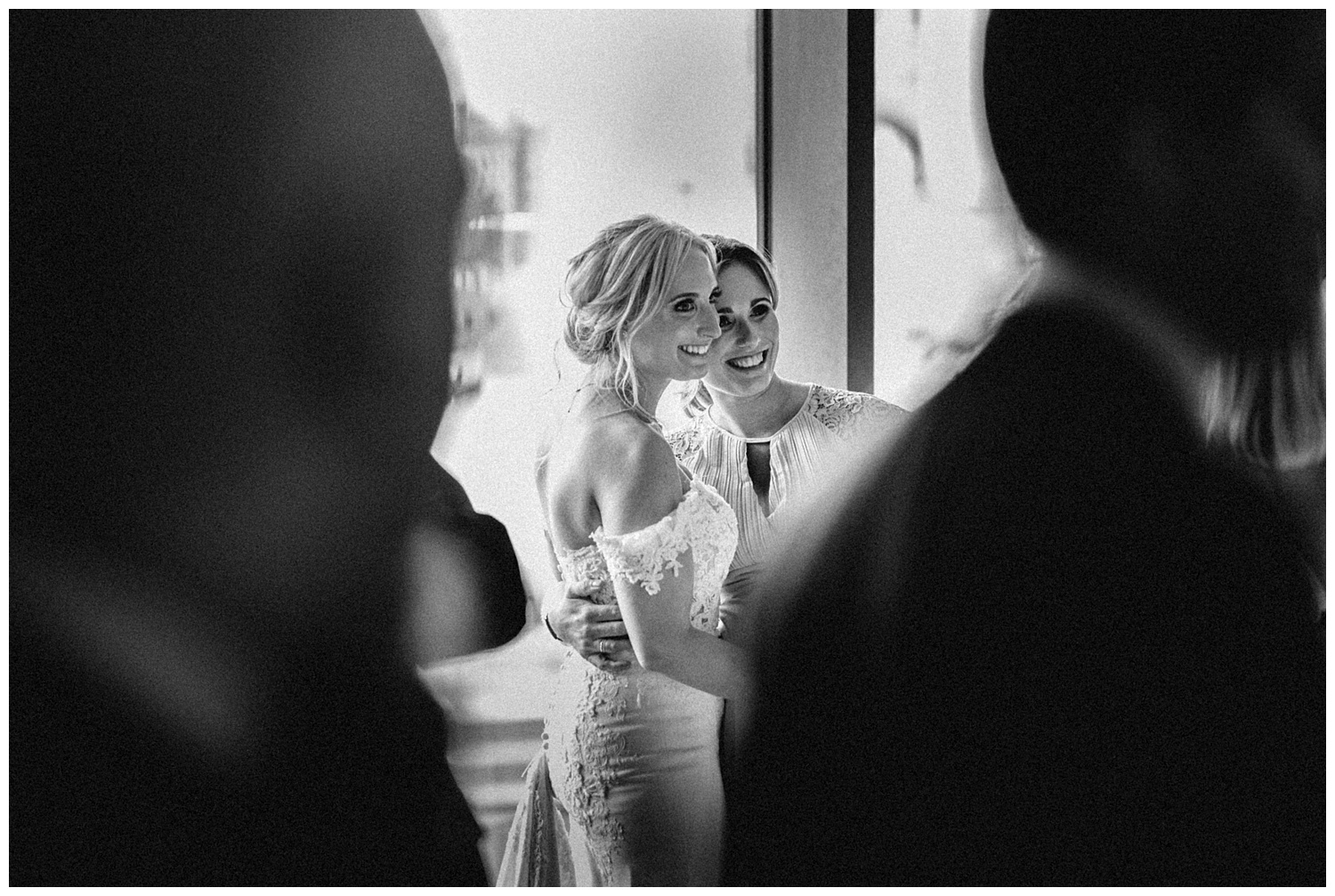 Bride and guest posing for picture